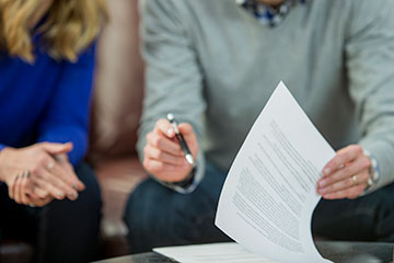 Couple signing an agreement