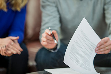 Couple signing a rental agreement