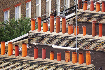 Chimney pots on roof of terraced housing showing party walls