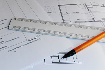 Plans on a table with ruler and pen